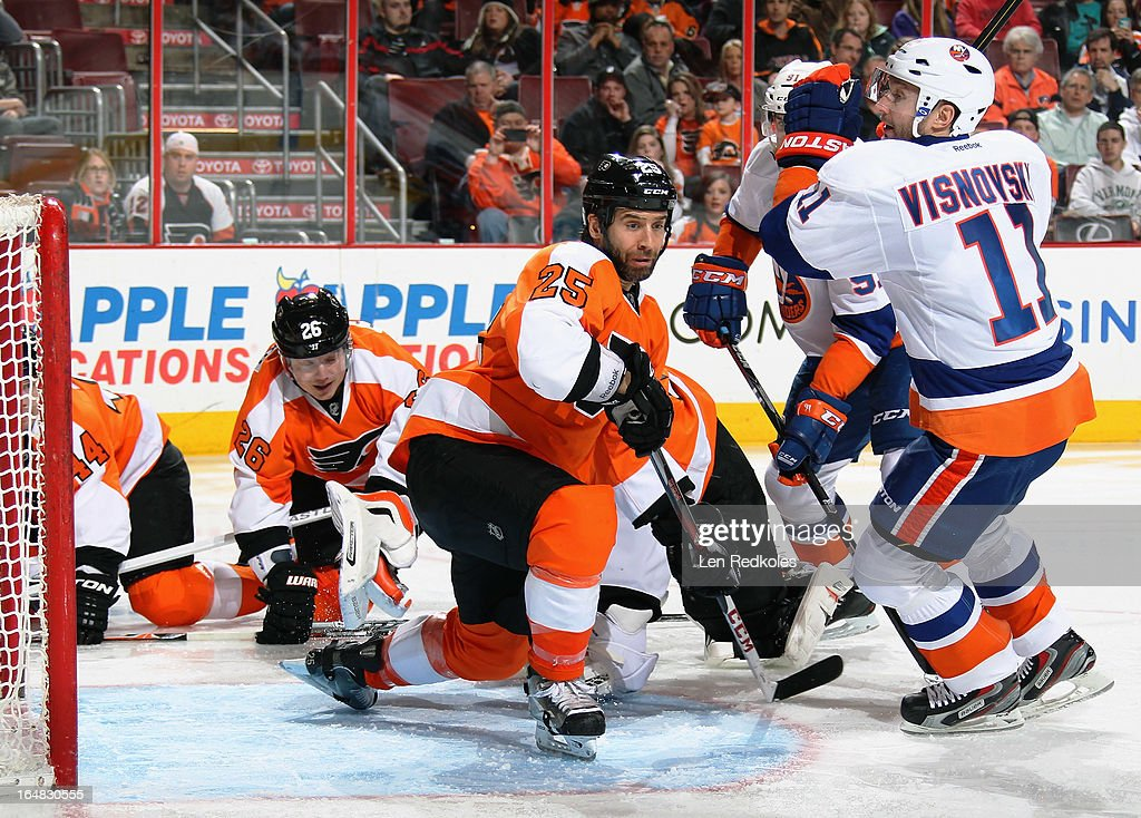 Maxime Talbot #25 of the Philadelphia Flyers defends his open net against Lubomir Visnovsky #11 of the New York Islanders in the third period on March 28, 2013 at the Wells Fargo Center in Philadelphia, Pennsylvania.