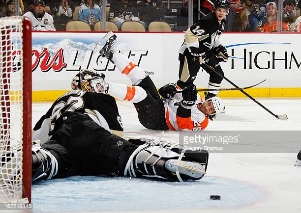 Maxime Talbot of the Philadelphia Flyers takes a diving shot between Tomas Vokoun and Chris Kunitz of the Pittsburgh Penguins on February 20, 2013 at...