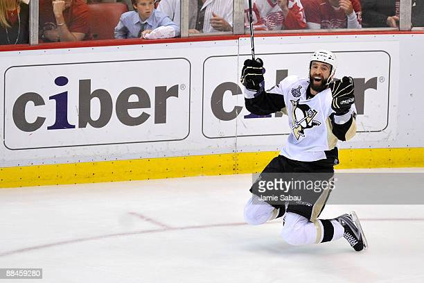 Maxime Talbot of the Pittsburgh Penguins celebrates after scoring his second goal of the second period against the Detroit Red Wings skates by during...