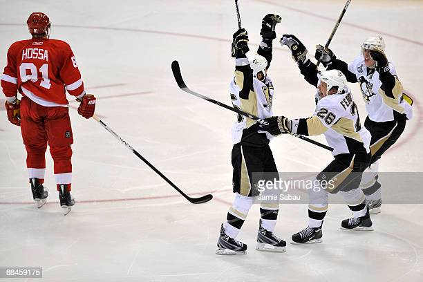 Maxime Talbot of the Pittsburgh Penguins celebrates his first goal in the second period with teammates Evgeni Malkin and Ruslan Fedotenko as Marian...