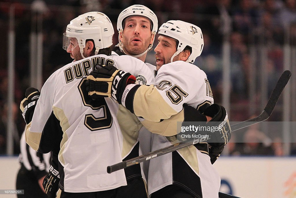 Maxime Talbot #25 of the Pittsburgh Penguins celebrates his goal with team mates Deryk Engelland #5 and Brooks Orpik #44 against the New York Rangers during their game on November 29, 2010 at Madison Square Garden in New York City.