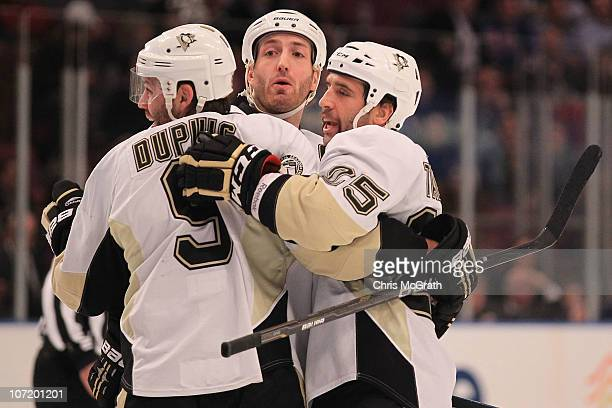 Maxime Talbot of the Pittsburgh Penguins celebrates his goal with team mates Deryk Engelland and Brooks Orpik against the New York Rangers during...