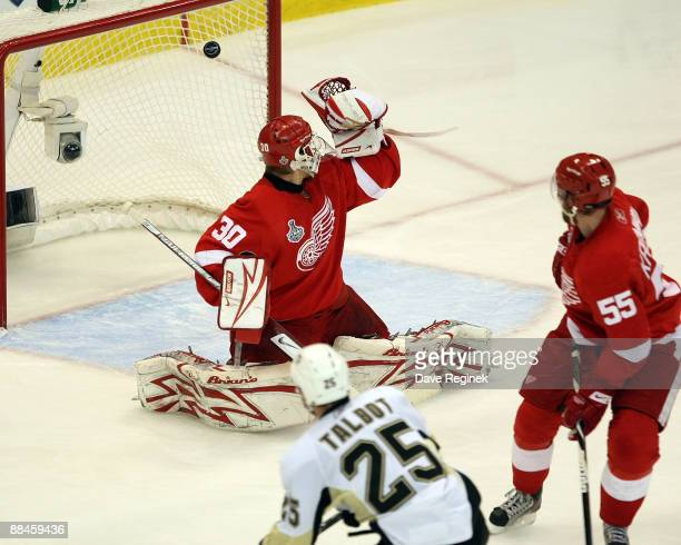 Maxime Talbot of the Pittsburgh Penguins scores on goalie Chris Osgood of the Detroit Red Wings as Niklas Kronwall watches during Game Seven of the...