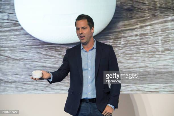 Maxime Veron director of product marketing at Nest Labs Inc holds a Nest Guard security base as he speaks during an event in San Francisco California...
