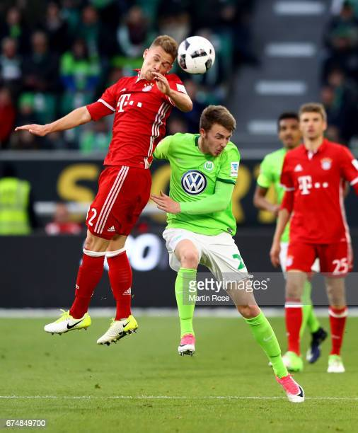 Maximilan Arnold of Wolfsburg and Joshua Kimmich of Muenchen head for the ball during the Bundesliga match between VfL Wolfsburg and Bayern Muenchen...