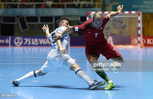 Maximilano Rescia of Argentina vies with Cardinal of Portugal during the FIFA Futsal World Cup Semi Final match between Argentina and Portugal at the...
