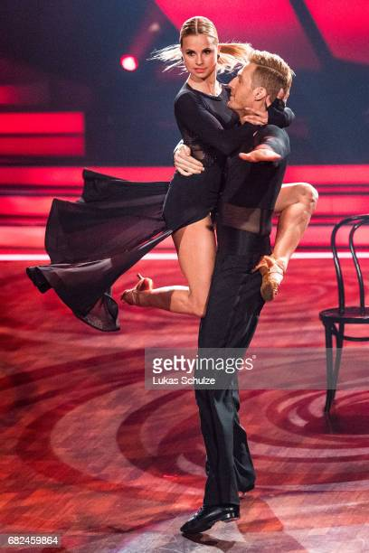 Maximilian Arland and Sarah Latton perform on stage during the 8th show of the tenth season of the television competition 'Let's Dance' on May 12...