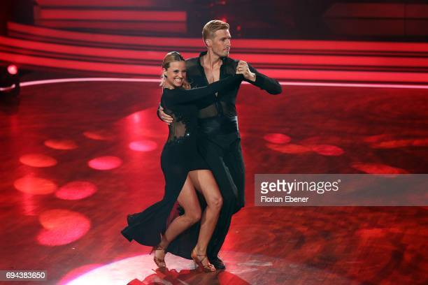 Maximilian Arland and Sarah Latton perform on stage during the final show of the tenth season of the television competition 'Let's Dance' on June 9...