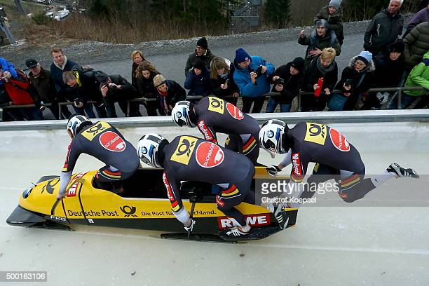 Maximilian Arndt, Alexander Roediger, Kevin Kuske and Ben Heber of Germany compete in their first run of the four men's bob competition during the...