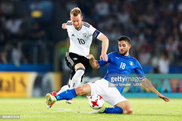 Maximilian Arnold of Germany and Roberto Gagliardini of Italy battle for possession during the 2017 UEFA European Under-21 Championship Group C match...