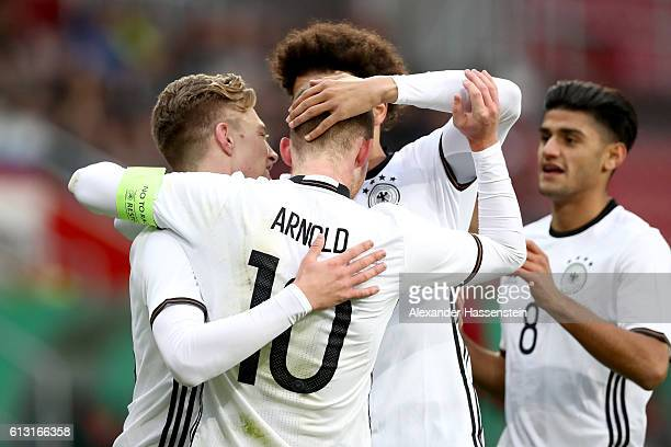 Maximilian Arnold of Germany celebrates scoring the opening goal with his team mates Mitchell Weiser Leroy Sane and Mahmoud Dahoude during the 2017...