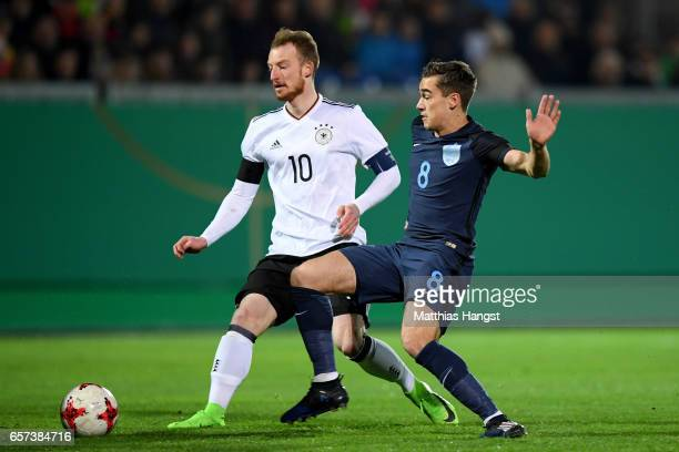 Maximilian Arnold of Germany is challenged by Harry Winks of England during the U21 international friendly match between Germany and England at...