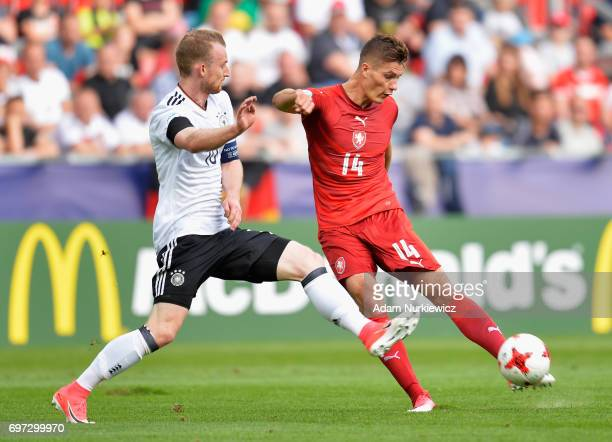 Maximilian Arnold of Germany puts pressure on Patrik Schick of Czech Republic during the UEFA European Under21 Championship Group C match between...