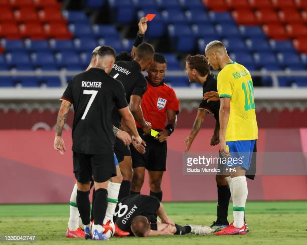 Maximilian Arnold of Team Germany is shown a red card by Match Referee, Ivan Barton during the Men's First Round Group D match between Brazil and...