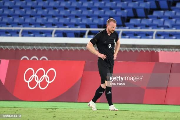 Maximilian Arnold of Team Germany looks dejected after being shown a red card during the Men's First Round Group D match between Brazil and Germany...