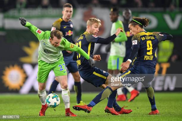 Maximilian Arnold of VfL Wolfsburg and Yussuf Poulsen of RB Leipzig battle for the ball during the Bundesliga match between VfL Wolfsburg and RB...