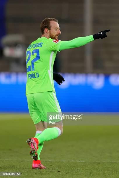Maximilian Arnold of VfL Wolfsburg celebrates after scoring their team's third goal during the Bundesliga match between DSC Arminia Bielefeld and VfL...