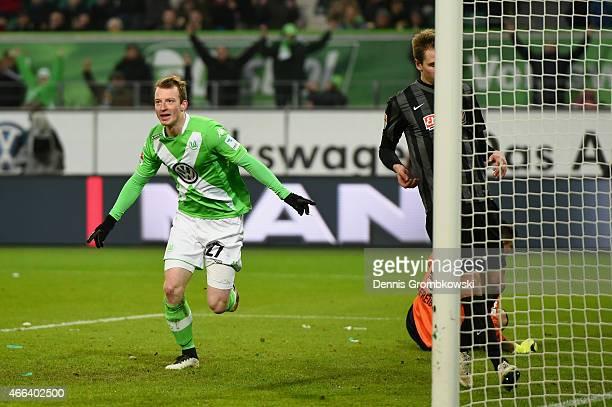 Maximilian Arnold of VfL Wolfsburg celebrates as he scores the third goal during the Bundesliga match between VfL Wolfsburg and SC Freiburg at...