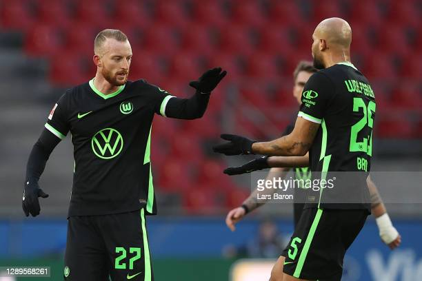 Maximilian Arnold of VfL Wolfsburg celebrates with teammate John Brooks after scoring his team's first goal during the Bundesliga match between 1. FC...