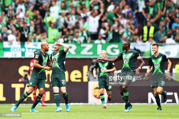 Maximilian Arnold of VfL Wolfsburg celebrates with teammates after scoring the opening goal during the Bundesliga match between VfL Wolfsburg and 1...