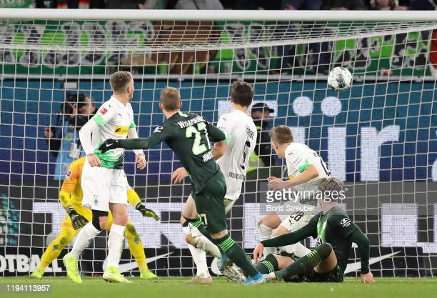 Maximilian Arnold of VfL Wolfsburg scores his team's second goal during the Bundesliga match between VfL Wolfsburg and Borussia Moenchengladbach at...