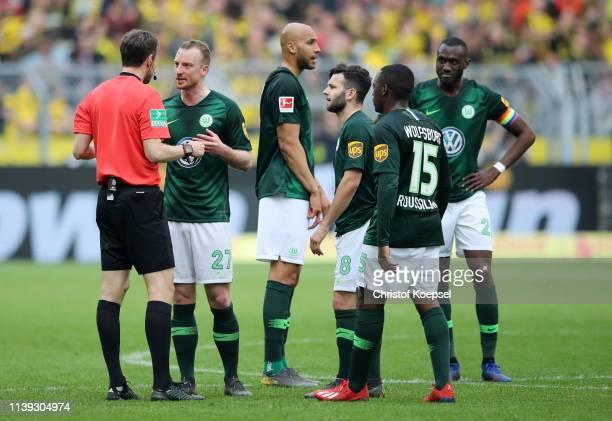 Maximilian Arnold of VfL Wolfsburg speaks to match referee Markus Schmidt during the Bundesliga match between Borussia Dortmund and VfL Wolfsburg at...