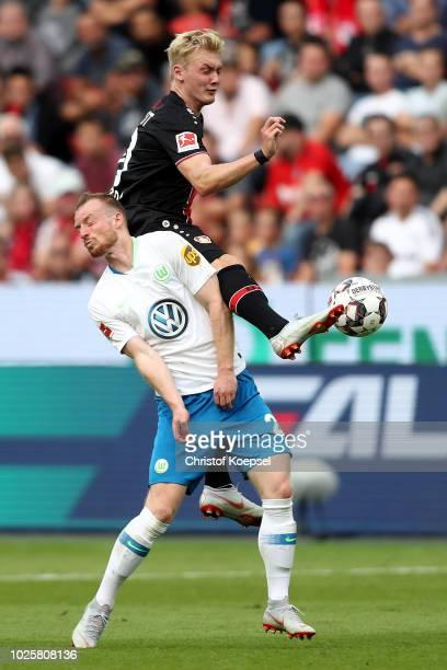 Maximilian Arnold of Wolfsburg and Julian Brandt of Leverkusen go up for a header during the Bundesliga match between Bayer 04 Leverkusen and VfL...