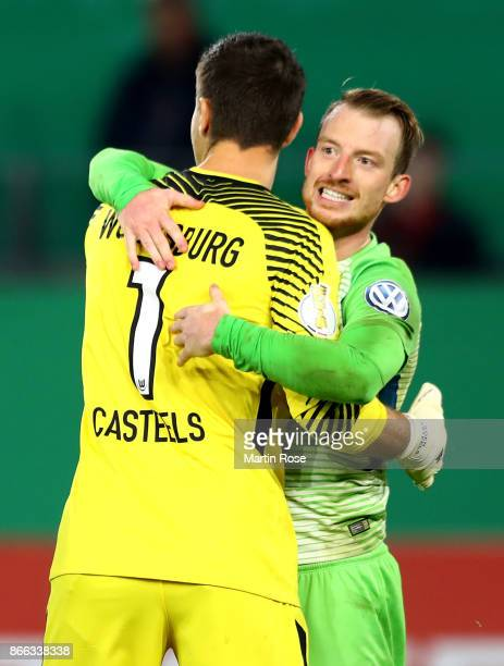 Maximilian Arnold of Wolfsburg celebrate victory with team mate Koen Casteels after the DFB Cup match between VfL Wolfsburg and Hannover 96 at...