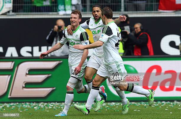 Maximilian Arnold of Wolfsburg celebrate with his team mates after he scores his team's opening goal during the Bundesliga match between VfL...