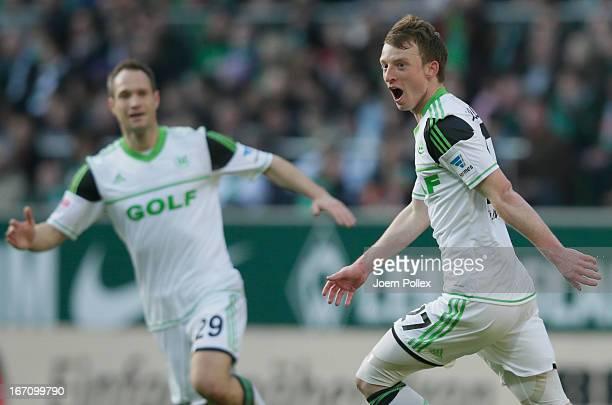 Maximilian Arnold of Wolfsburg celebrates after scoring his team's first goal during the Bundesliga match between SV Werder Bremen and VfL Wolfsburg...