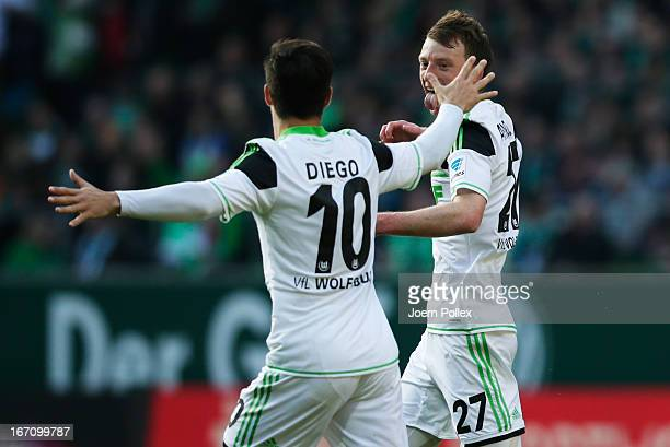 Maximilian Arnold of Wolfsburg celebrates with his team mate Diego after scoring his team's first goal during the Bundesliga match between SV Werder...
