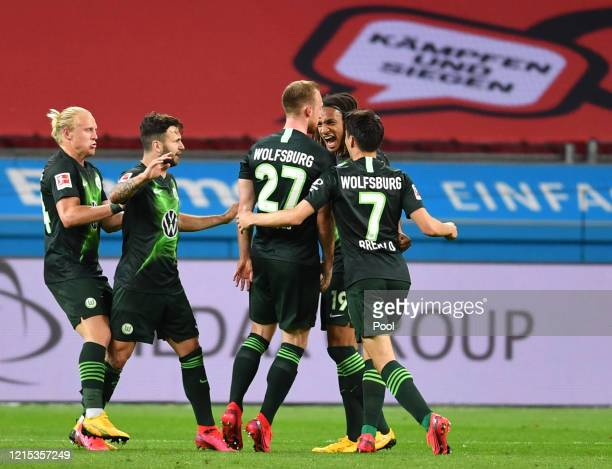 Maximilian Arnold of Wolfsburg celebrates with team mates after scoring his sides second goal during the Bundesliga match between Bayer 04 Leverkusen...