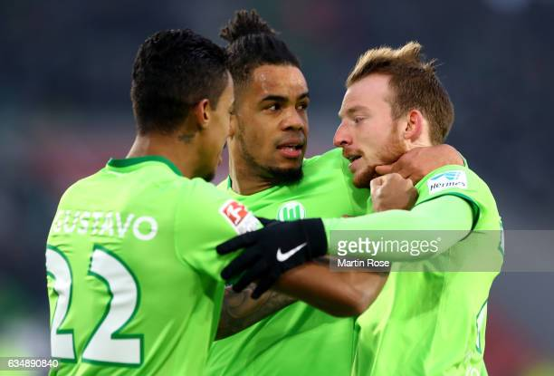 Maximilian Arnold of Wolfsburg celebrates with team mates after scoring his teams first goal during the Bundesliga match between VfL Wolfsburg and...
