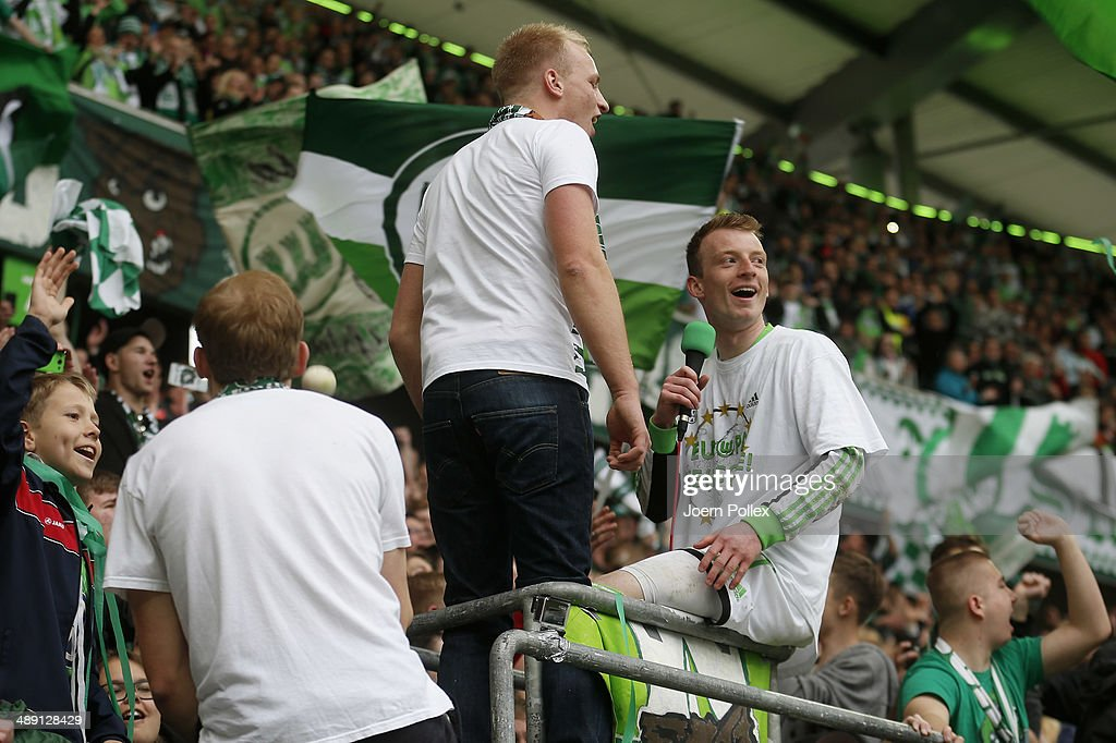 Maximilian Arnold of Wolfsburg celebrates with the fans after the Bundesliga match between at Volkswagen Arena on May 10, 2014 in Wolfsburg, Germany.