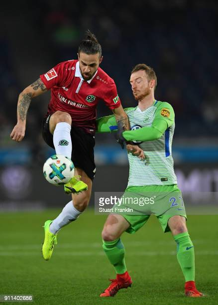 Maximilian Arnold of Wolfsburg is challenged by Martin Harnik of Hannover during the Bundesliga match between Hannover 96 and VfL Wolfsburg at...