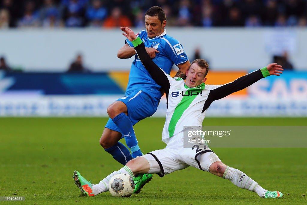 Maximilian Arnold (R) of Wolfsburg is challenged by Sejad Salihovic of Hoffenheim during the Bundesliga match between 1899 Hoffenheim and VfL Wolfsburg at Wirsol Rhein-Neckar-Arena on March 2, 2014 in Sinsheim, Germany.