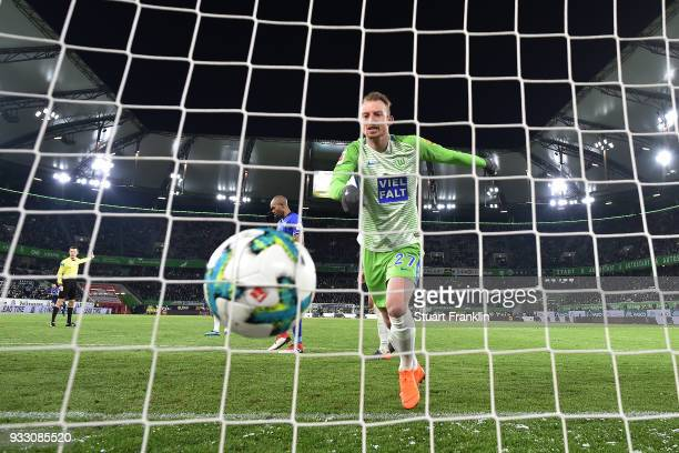 Maximilian Arnold of Wolfsburg looks dejected after Robin Knoche of Wolfsburg scored an own goal to make it 01 during the Bundesliga match between...