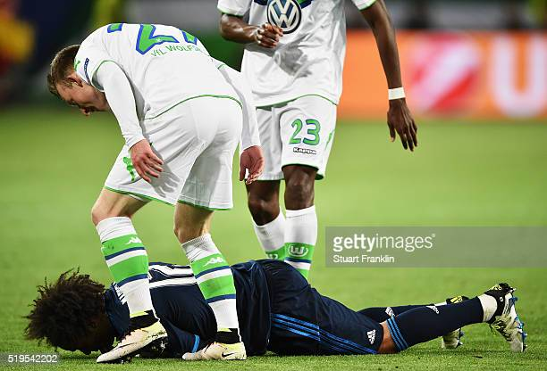 Maximilian Arnold of Wolfsburg makes a point to Marcelo of Real Madrid during the UEFA Champions League Quarter Final First Leg match between VfL...