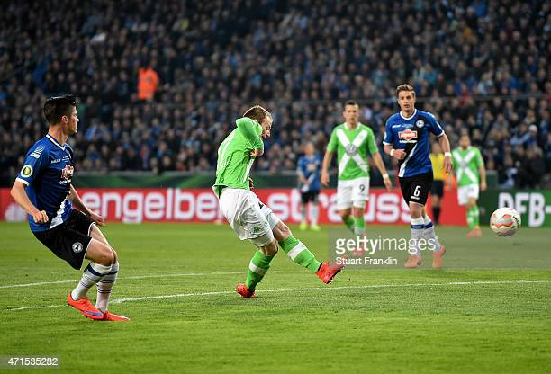 Maximilian Arnold of Wolfsburg scores his team's first goal during the DFB Cup Semi Final match between Arminia Bielefeld and VfL Wolfsburg at...