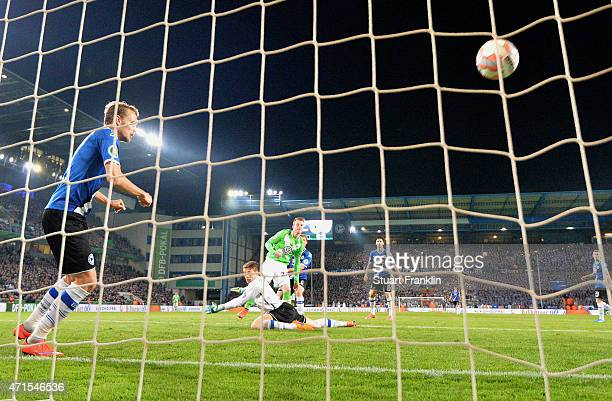 Maximilian Arnold of Wolfsburg scores his team's fourth goal during the DFB Cup Semi Final match between Arminia Bielefeld and VfL Wolfsburg at...