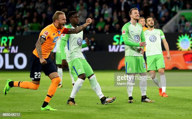 Maximilian Arnold of Wolsburg reacts after he fails to score the opening goal by penalty during the Bundesliga match between VfL Wolfsburg and TSG...