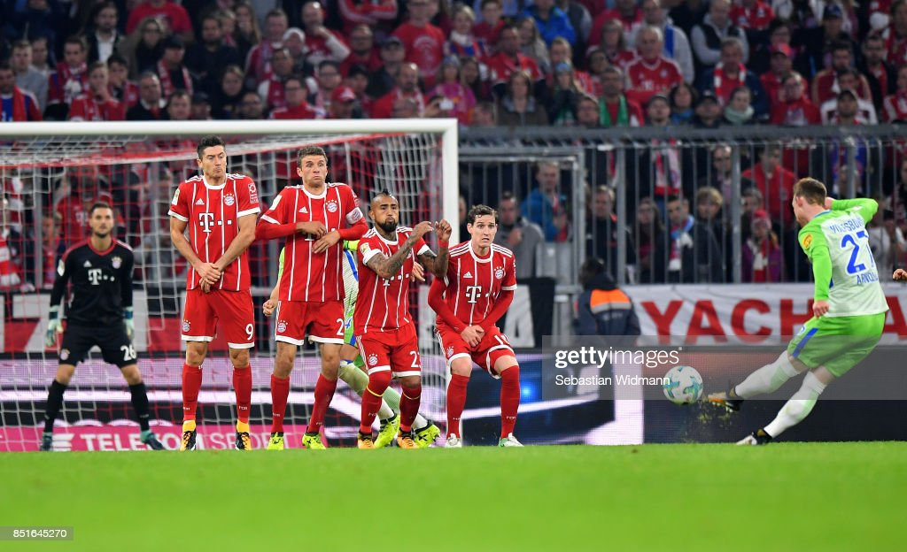 Maximilian Arnold scores a goal of Wolfsburg battle for the ball during the Bundesliga match between FC Bayern Muenchen and VfL Wolfsburg at Allianz Arena on September 22, 2017 in Munich, Germany.
