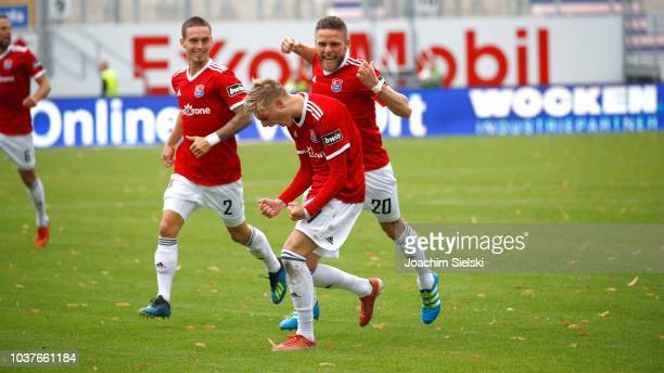 Maximilian Bauer Dominik Stahl and Finn Porath of Unterhaching celebration the Goal 12 for Unterhaching during the 3 Liga match between SV Meppen and...