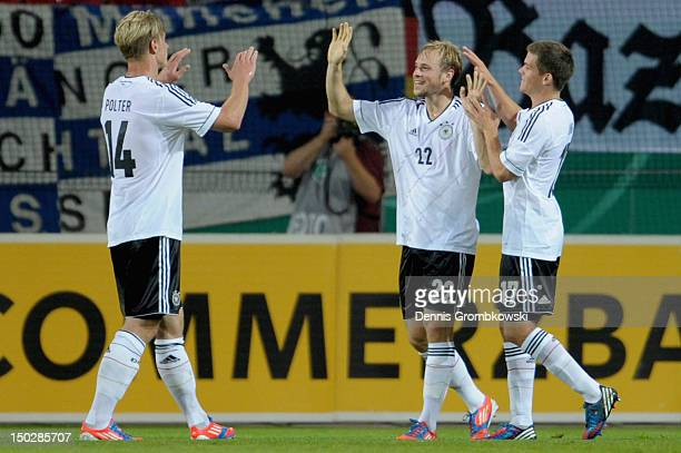 Maximilian Beister of Germany celebrates with teammates Sebastian Polter and Sebastian Jung after scoring his team's first goal during the Under 21...