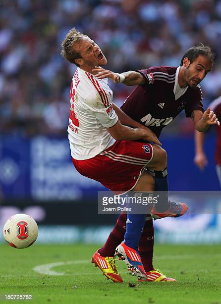 Maximilian Beister of Hamburg and Javier Pinola of Nuernberg compete for the ball during the Bundesliga match between Hamburger SV and 1 FC Nuernberg...