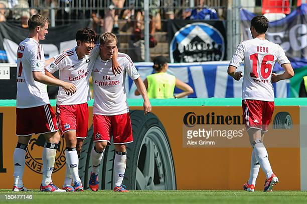 Maximilian Beister of Hamburg celebrates his team's second goal with team mates Marcell Jansen HeungMin Son and Marcus Berg during the first round...