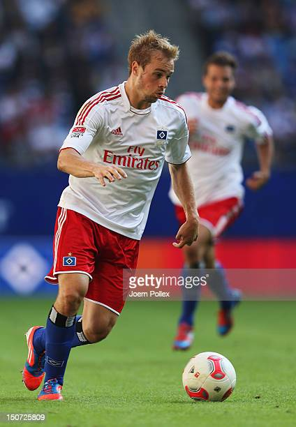 Maximilian Beister of Hamburg controls the ball during the Bundesliga match between Hamburger SV and 1 FC Nuernberg at Imtech Arena on August 25 2012...