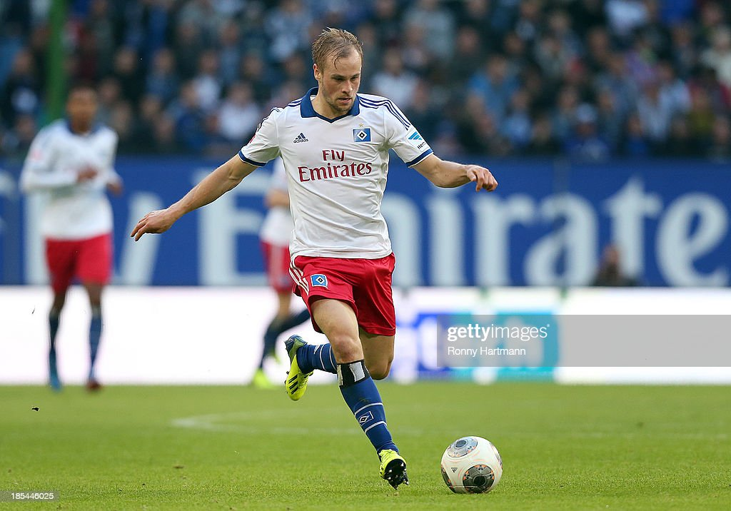 Maximilian Beister of Hamburg runs with the ball during the Bundesliga match between Hamburger SV and VfB Stuttgart at Imtech Arena on October 20, 2013 in Hamburg, Germany.