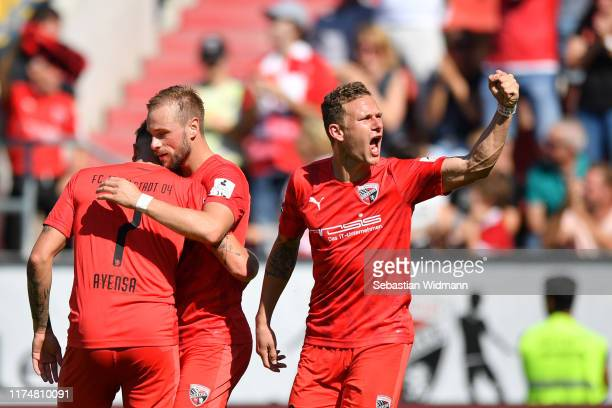 Maximilian Beister of Ingolstadt celebrates with team mates Dennis Eckert Ayensa and Marcel Gaus after scoring his team's first goal during the 3....