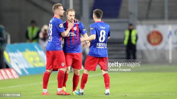 Maximilian Beister of Krefeld celebrates the first goal with Manuel Konrad of Krefeld and Maurice Litka during the 3 Liga match between KFC Uerdingen...